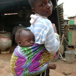 Girl and baby sister in Tishegu