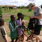 Jesse giving a group of kids in Ghanasco his e-mail address